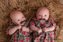 twin boys with little moustaches