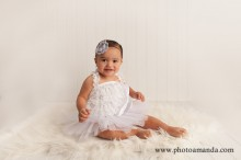 baby girl in white lace and tutu