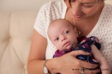 8 week baby girl in moms arms