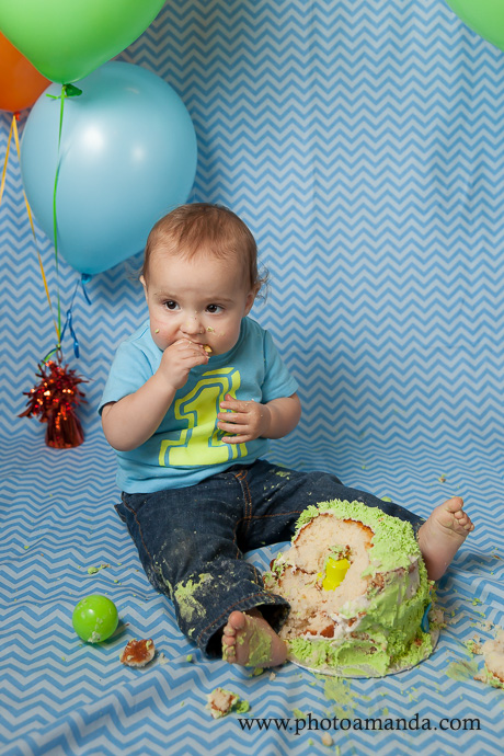 little boy smashing monster cake