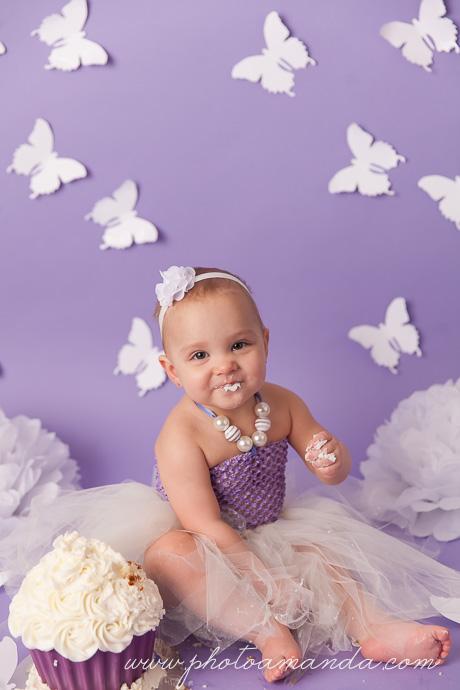 little girl first birthday cake smash purple