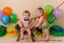 twin 1 year old boys in diaper covers and matching bow ties