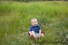 first birthday boy sitting in basket