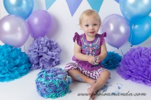purple and blue cake smash for a little girl