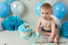 cute little boy eating birthday cake