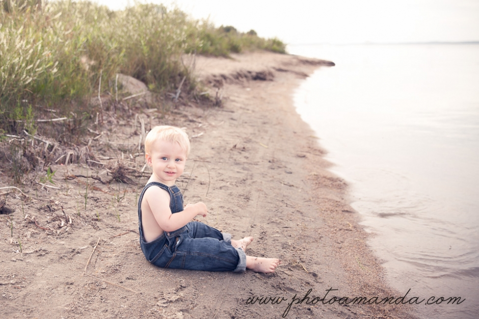 little boy sitting on beach