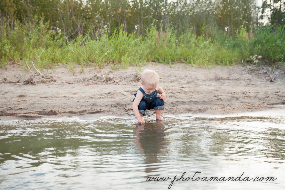 little boy playing in the water